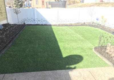 Artificial turf beautifully displayed in the yard of residential property in Nebraska.