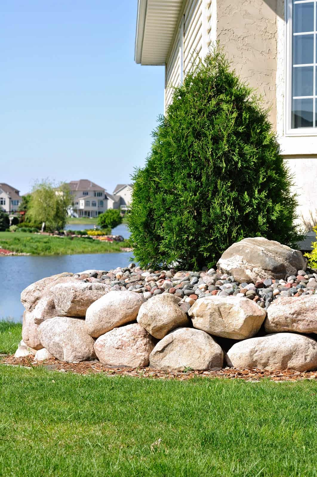 Precision landscape design with a stone retaining wall.